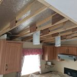A ceiling board repair in a static caravan